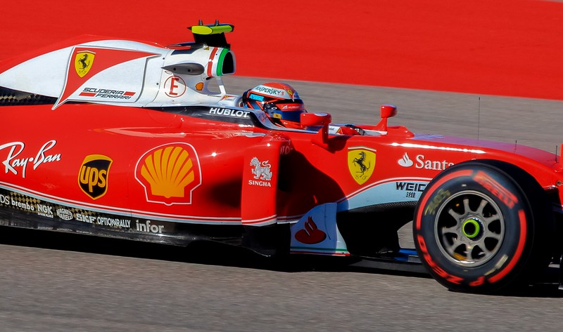 Closeup of Kimi Raikonnen . Notice how much more protected the modern drivers are than in the older F1 cars .