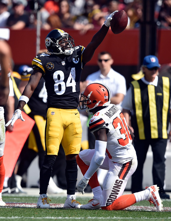 . Pittsburgh Steelers wide receiver Antonio Brown (84) celebrates a first down catch as Cleveland Browns defensive back Jason McCourty (30) watches during the second half of an NFL football game, Sunday, Sept. 10, 2017, in Cleveland. (AP Photo/David Richard)