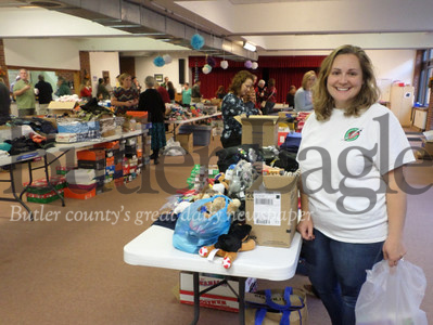 Shannon Kooser, drop-off team leader for Operation Christmas Child, oversees a packing party in Sarver last year.