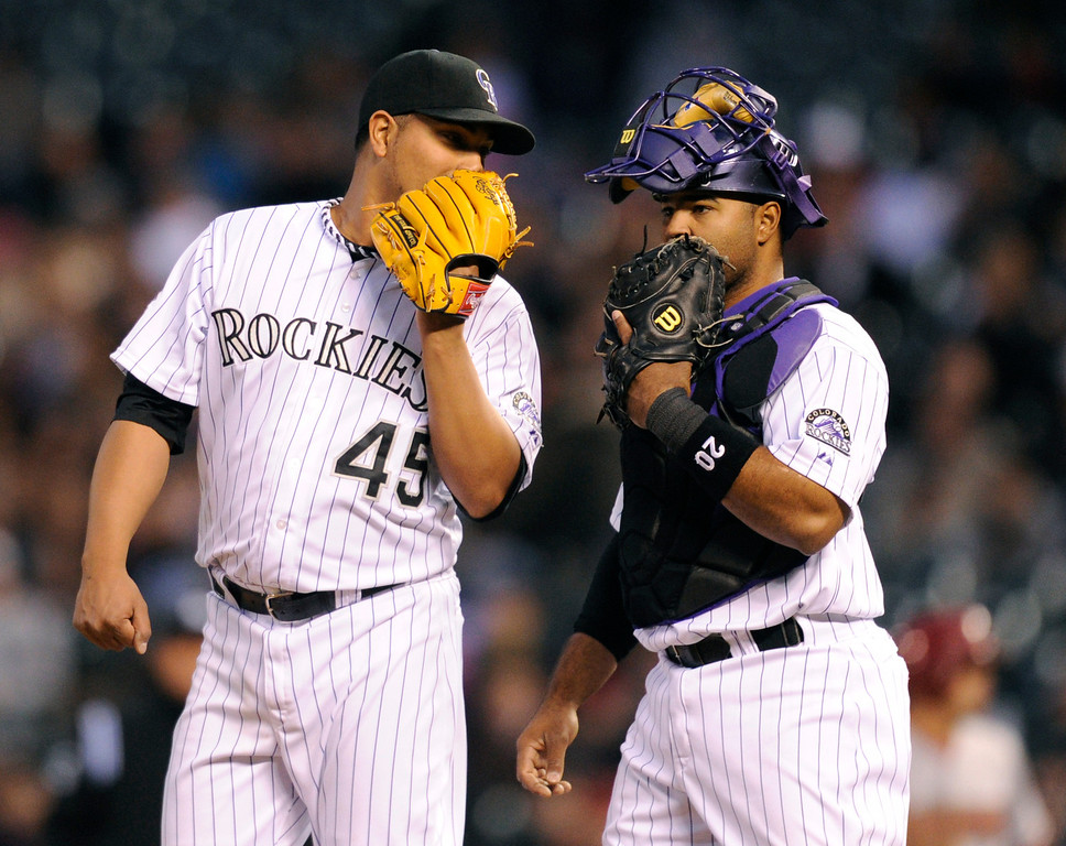 . DENVER, CO. - APRIL 19:  Colorado starting pitcher Jhoulys Chacin and catcher Wilin Rosario had a private conversation on the mound in the third inning. The Colorado rockies hosted the Arizona Diamondbacks at Coors Field Friday night, April 19, 2013.  Photo By Karl Gehring/The Denver Post)