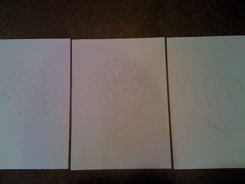 Madeline draws hands on the back of all her schoolwork.  future hand model?