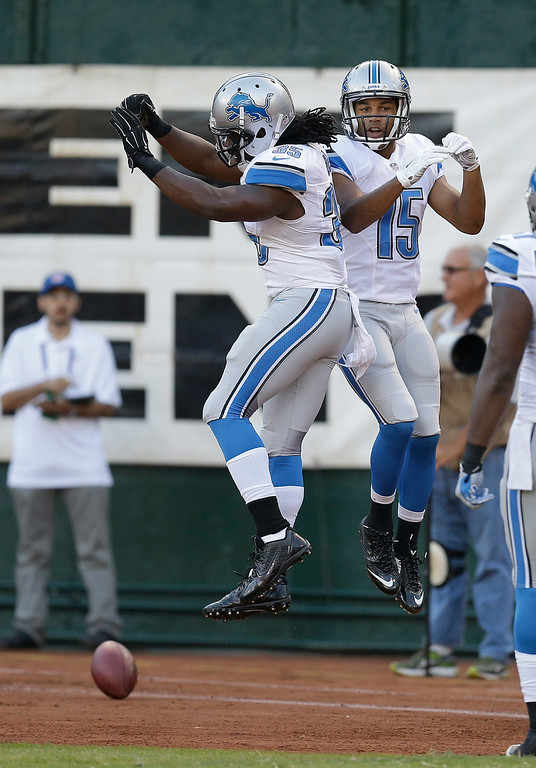. Detroit Lions wide receiver Golden Tate, right, celebrates after scoring on a 28-yard touchdown reception with running back Joique Bell during the first quarter of an NFL preseason football game against the Oakland Raiders in Oakland, Calif., Friday, Aug. 15, 2014. (AP Photo/Ben Margot)