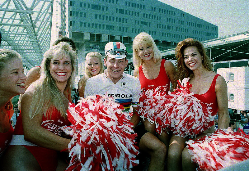 . World champion cyclist Lance Armstrong of the United States poses with cheerleaders before start of the first stage of the Tour de France cycling race in Lille, northern France, Sunday, July 3, 1994. (AP Photo/Laurent Rebours)