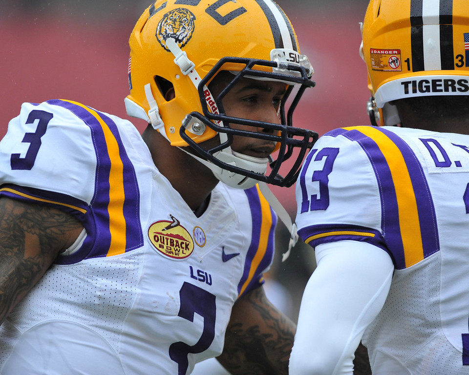 . Wide receiver O\'Dell Beckham Jr. #3 of the LSU Tigers warms up for play against the Iowa Hawkeyes January 1, 2014  in the Outback Bowl at Raymond James Stadium in Tampa, Florida.  (Photo by Al Messerschmidt/Getty Images)