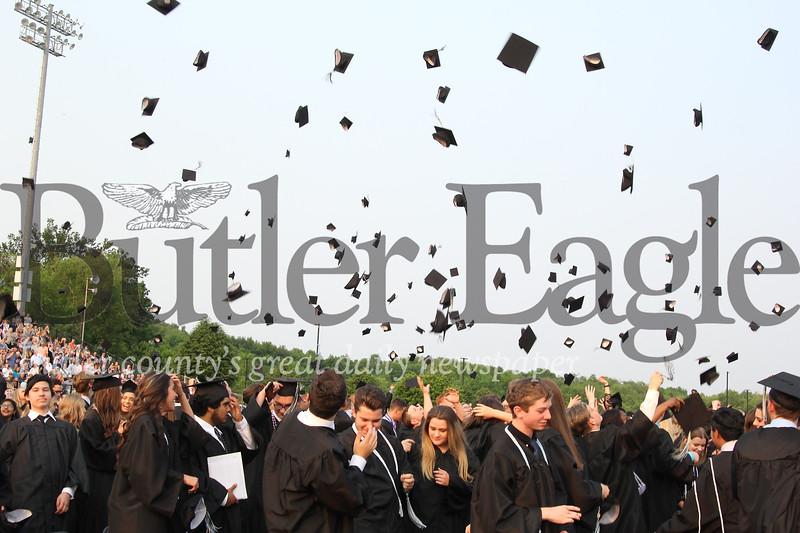 Seneca class of 2019 graduates throw their caps in the air to close Friday night's ceremony.