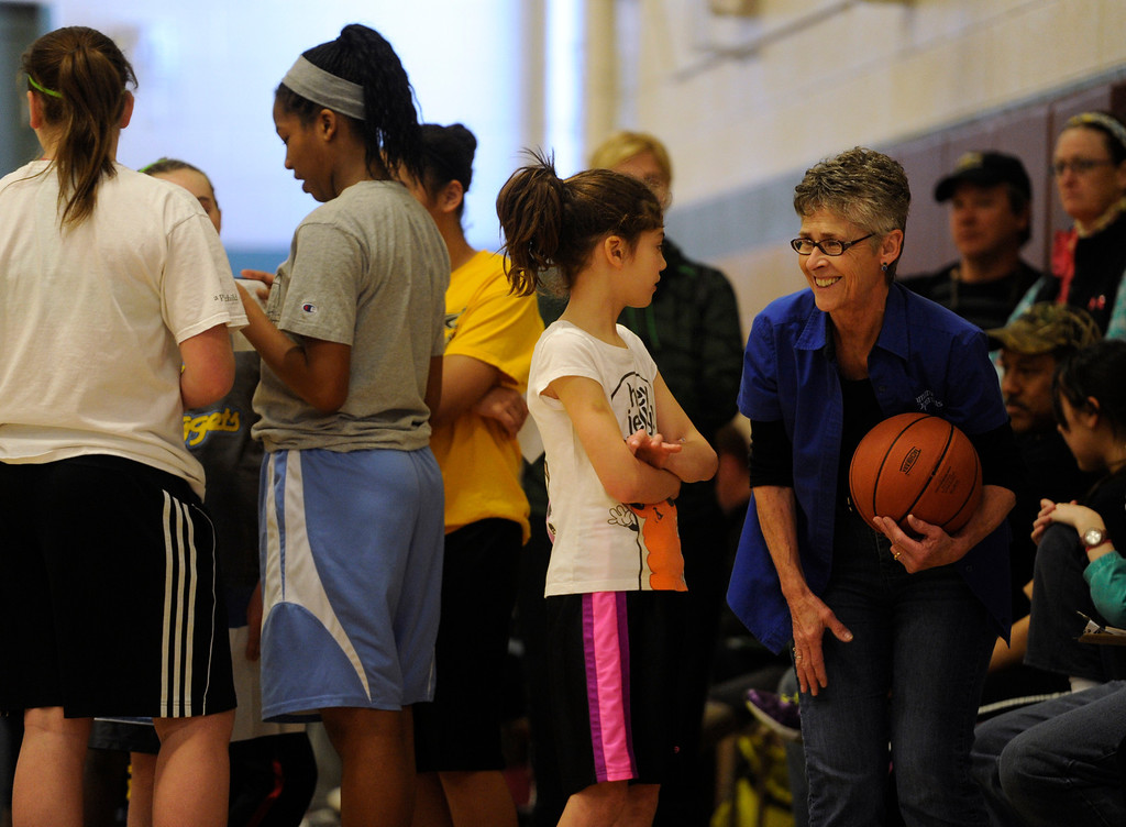 . DENVER, CO. - FEBRUARY 23: Optimist volunteer Judy Peters, right, helps the kids with the rules of the competition. The Tamarac Optimist Club sponsors one of the Tri-Star Basketball Competitions at the Eisenhower Recreation Center in Denver. The competitions are held over a several week period for boys and girls 8-13 years-old. The winners from this competition go on to the regional finals, and those winners will play in the final competition on Mar. 23, 2013 at the Pepsi Center before a Nuggets game. There are still several opportunities for kids to try out. Go to www.tristarbasketball.org for upcoming times and locations. (Photo By Kathryn Scott Osler/The Denver Post)