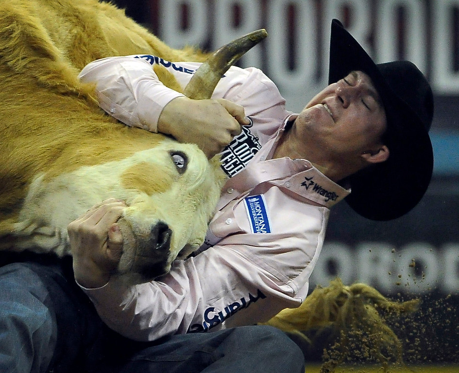 . Ty Erickson of Helena, Mont. competes in the steer wrestling during the fifth go-round of the National Finals Rodeo at the Thomas & Mack Center on Monday, Dec. 8, 2014, in Las Vegas. (AP Photo/Las Vegas Review Journal, David Becker)