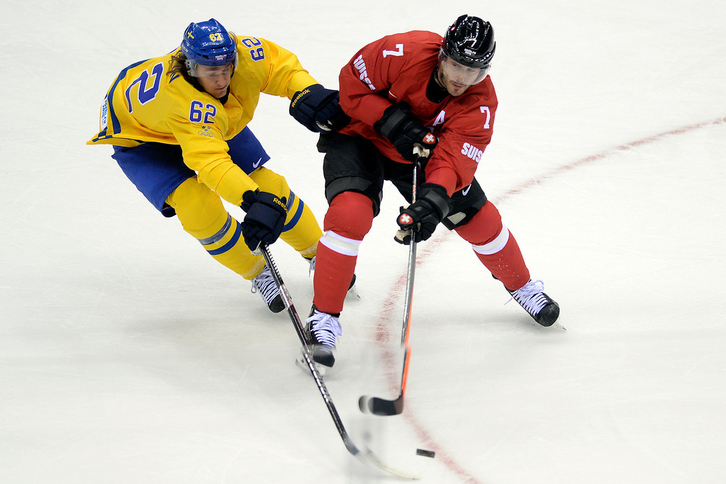 . Sweden\'s Carl Hagelin defends Switzerland\'s Mark Streit during the action at Bolshoy Arena. Sochi 2014 Winter Olympics on Friday, February 14, 2014. (Photo by AAron Ontiveroz/The Denver Post)