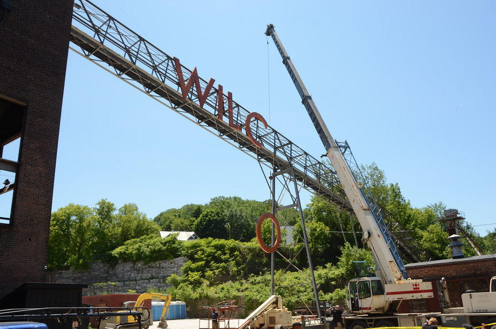 . Gillian Jones/North Adams Transcript Using a crane, the letters for the band WILCO are raised and secured to the old coal conveyer chute on the Mass MoCA campus on Wednesday afternoon in preparation for this week\'s Solid Sound weekend.