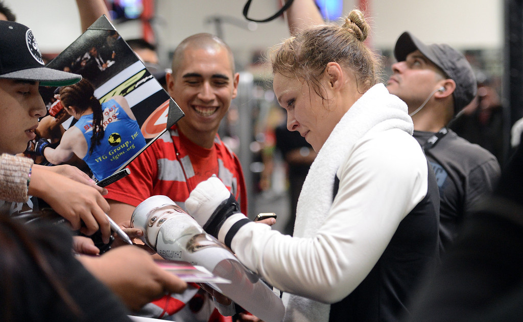 . UFC fighter Ronda Rousey says hello to fans after an open workout at the UFC Gym in Torrance, CA Wednesday, February 20, 2013. (Hans Gutknecht/Staff Photographer)