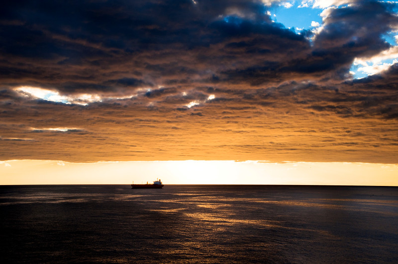 A freight ship in the middle of the sunset off St. Maarten.
