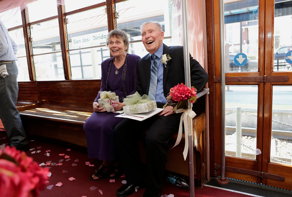 . Ralph and Mary Lou Watkins celebrate their 60th wedding anniversary on Valentine\'s Day aboard a Santa Clara Valley Transportation Authority historic trolley at the Diridon Station in San Jose, Calif. on Thursday, Feb. 14, 2013. Ralph, 82, and Mary Lou, 79, won an essay contest sponsored by the VTA to have the opportunity to renew their vows on historic trolley, Car 2001. The couple held a private ceremony aboard the trolley and held a brief reception on the VTA Light Rail platform.  (Gary Reyes/ Staff)