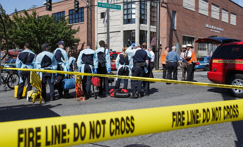 """. Authorities respond to a shooting at Seattle Pacific University campus Thursday, June 5, 2014, in Seattle. The university posted online Thursday that \""""the campus is in lockdown due to a shooting near Otto Miller Hall.\"""" (AP Photo/The Seattle Times, Dean Rutz)"""