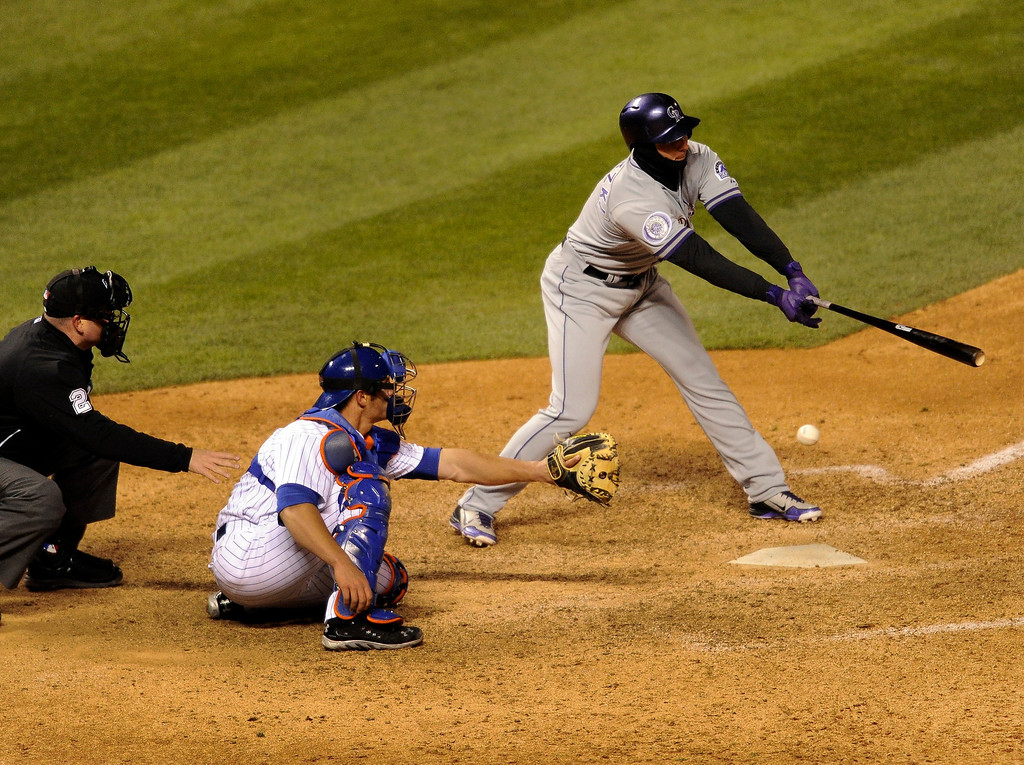 . DENVER, CO. - APRIL 16:  Troy Tulowitzki fanned on a pitch and struck out with the bases loaded to end the seventh inning. The Colorado Rockies hosted the New York Mets in the second game of a doubleheader Tuesday night, April 16, 2013. Monday night\'s game was snowed out at Coors Field.  Photo By Karl Gehring/The Denver Post)