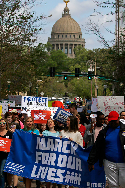 ". People march while participating in a ""March for Our Lives\"" rally in Jackson, Miss., Saturday, March 24, 2018. Students and activists across the country planned events Saturday in conjunction with a Washington march spearheaded by teens from Marjory Stoneman Douglas High School in Parkland, Fla., where over a dozen people were killed in February. (AP Photo/Rogelio V. Solis)http://epix.ap.org/#"