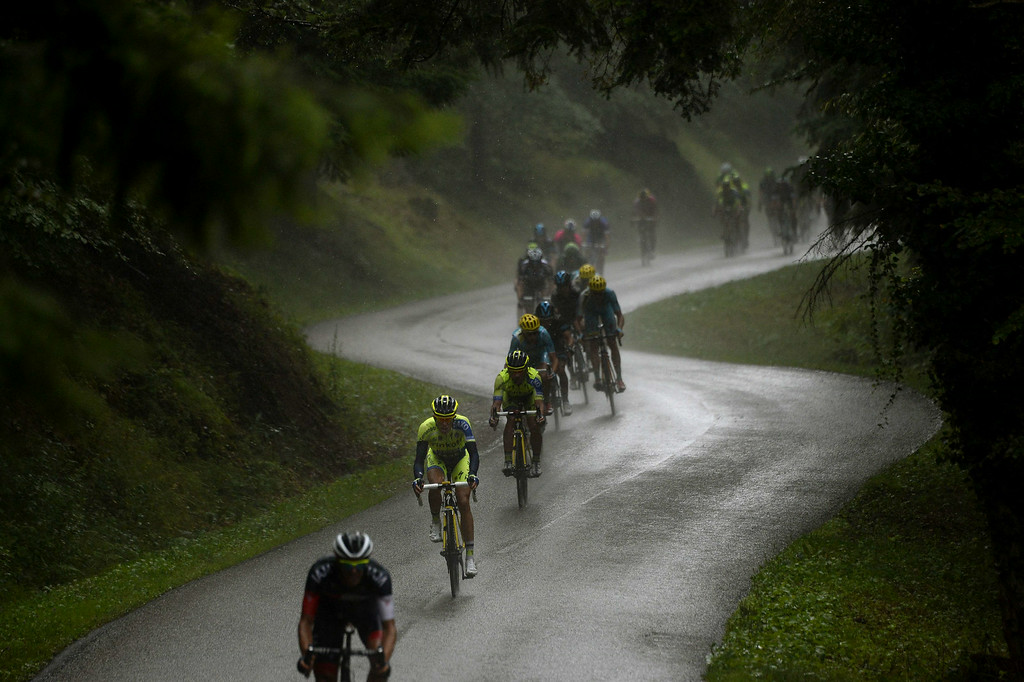 . Spain\'s Alberto Contador (2nd front) rides in the pack during the 161.50 km tenth stage of the 101st edition of the Tour de France cycling race on July 14, 2014 between Mulhouse and La Planche des Belles Filles ski resort, eastern France.  AFP PHOTO / LIONEL  BONAVENTURE/AFP/Getty Images