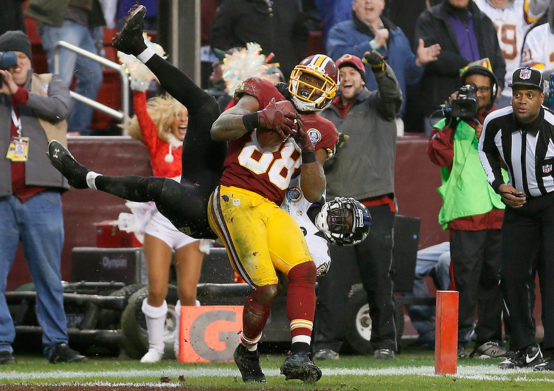 . LANDOVER, MD - DECEMBER 09:  Wide receiver Pierre Garcon #88 of the Washington Redskins catches a touchdown pass late in the fourth quarter in front of free safety Ed Reed #20 of the Baltimore Ravens during the Redskins 31-28 overtime win at FedExField on December 9, 2012 in Landover, Maryland.  (Photo by Rob Carr/Getty Images)