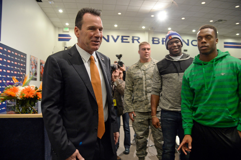 . Denver Broncos head coach Gary Kubiak meets with a few players that were on hand during his press conference January 20, 2015 at Dove Valley. Kubiak becomes the 15th head coach in franchise history. (Photo By John Leyba/The Denver Post)