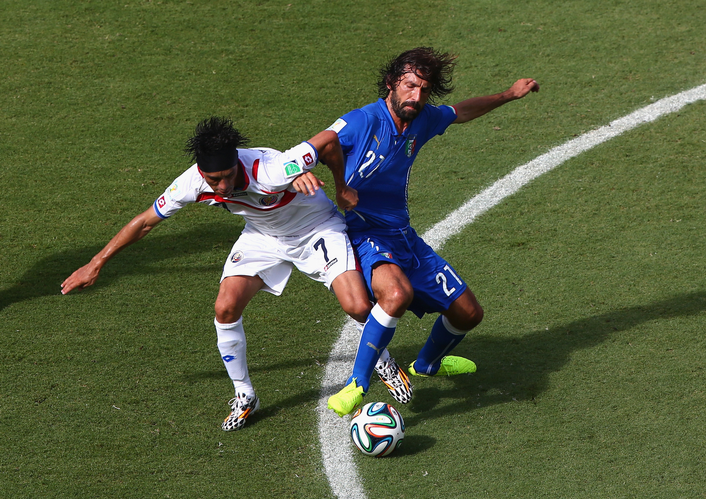 . Christian Bolanos of Costa Rica and Andrea Pirlo of Italy compete for the ball during the 2014 FIFA World Cup Brazil Group D match between Italy and Costa Rica at Arena Pernambuco on June 20, 2014 in Recife, Brazil.  (Photo by Michael Steele/Getty Images)