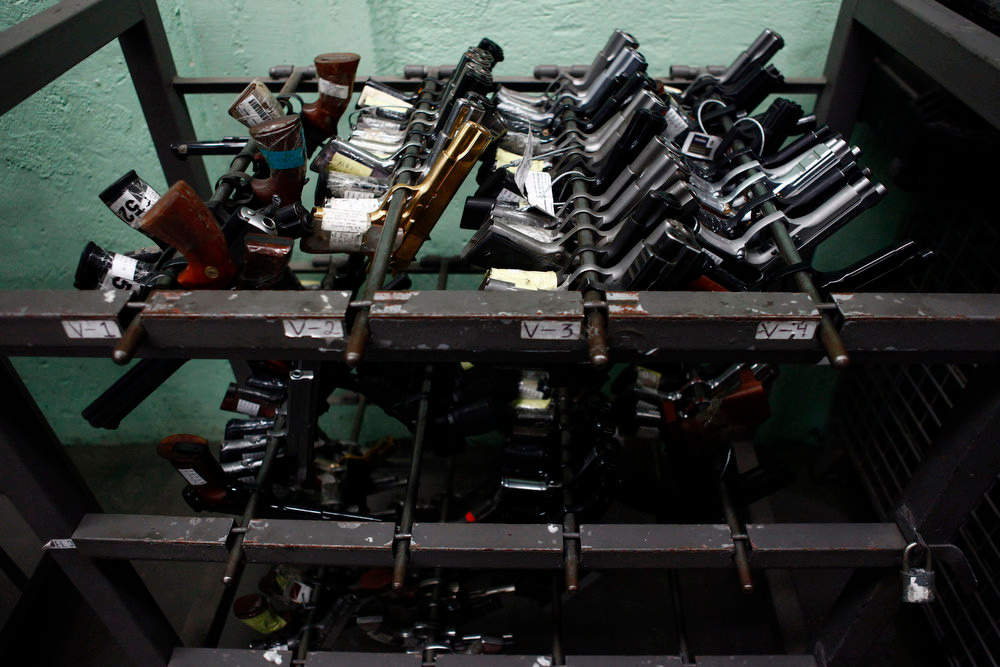 . Confiscated arms are shown inside of the deposit of weapons seized by national security authorities at a military zone of Mexico City April 17, 2013. The military is in charge of storing and destroying weapons, not only those handed in by the civilian population sometimes including those inherited from an ancestor who might have fought in the revolution but also the weapons confiscated in the six-year-long, ongoing drug war that has so far killed some 70,000 people. Picture taken April 17, 2013. REUTERS/Edgard Garrido