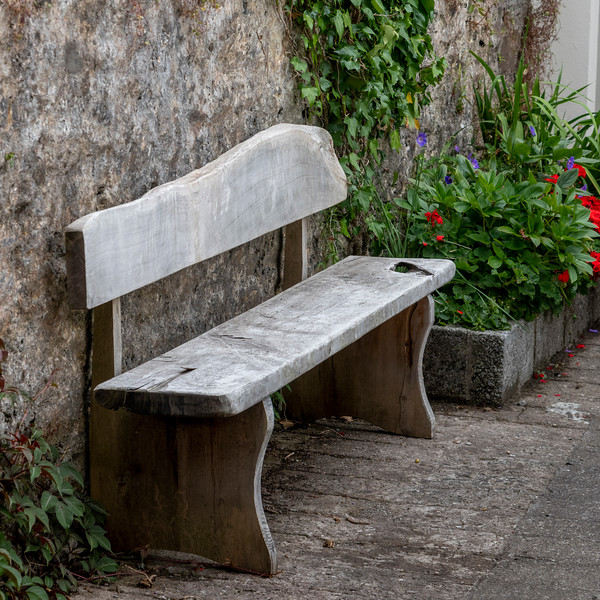 Old wooden bench in front of wall, Dingle, Dingle Peninsula, County Kerry, Republic of Ireland