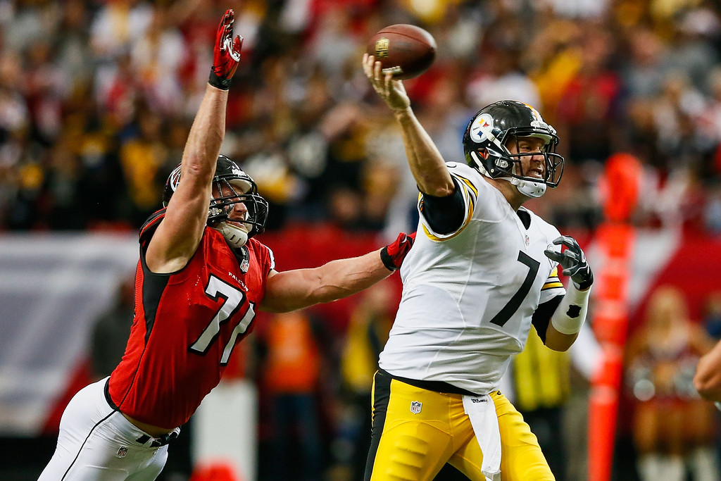 . ATLANTA, GA - DECEMBER 14: Ben Roethlisberger #7 of the Pittsburgh Steelers is pressured by Kroy Biermann #71 of the Atlanta Falcons in the first half at the Georgia Dome on December 14, 2014 in Atlanta, Georgia.  (Photo by Kevin C. Cox/Getty Images)