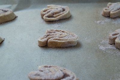 Cinnamon palmiers on a parchment-lined baking sheet