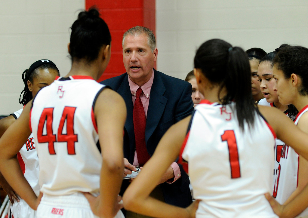 . Raiders coach Carl Mattei talked to the team during a time out. The Regis Jesuit High School girl\'s  basketball team defeated Grandview 59-53 Saturday night, January 12, 2013. Karl Gehring/The Denver Post