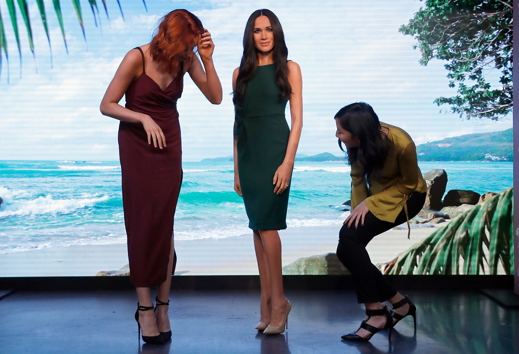 . Visitors look at Britain\'s Prince Harry\'s fiancee Meghan Markle, who is on display as wax figure at Madame Tussauds in London, Wednesday, May 9, 2018. As the world eyes are on the upcoming royal wedding, Madame Tussauds London unveils Meghan Markle\'s figure. (AP Photo/Frank Augstein)