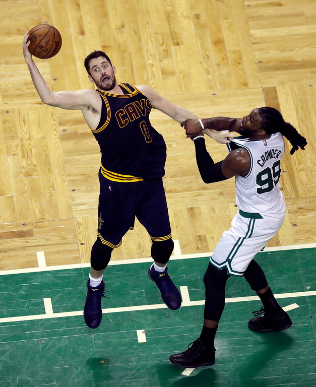 . Cleveland Cavaliers forward Kevin Love, left, and Boston Celtics forward Jae Crowder grab hold of each other during the second quarter of Game 1 of the NBA basketball Eastern Conference finals, Wednesday, May 17, 2017, in Boston. (AP Photo/Charles Krupa)