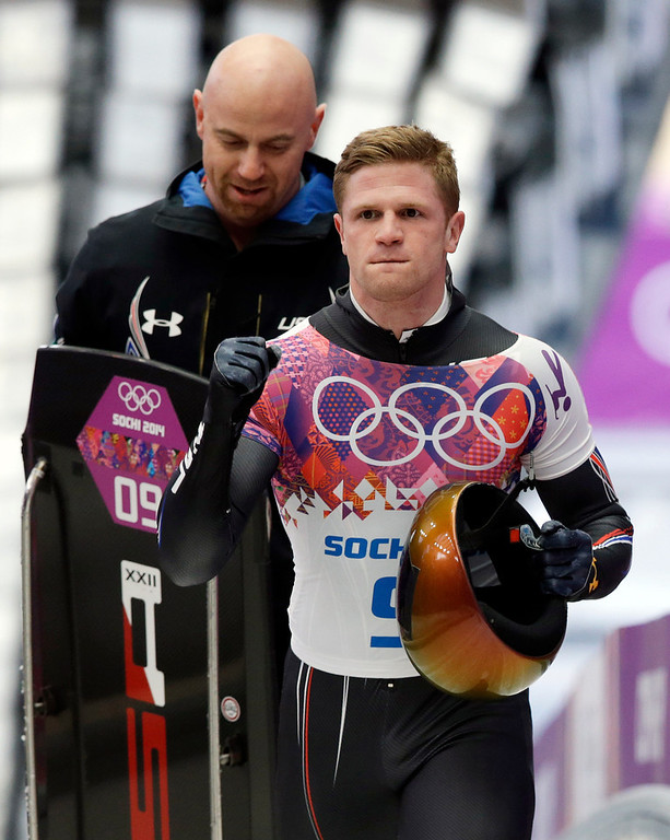 . John Daly of the United States cheers after his first run during the men\'s skeleton competition at the 2014 Winter Olympics, Friday, Feb. 14, 2014, in Krasnaya Polyana, Russia. (AP Photo/Dita Alangkara)