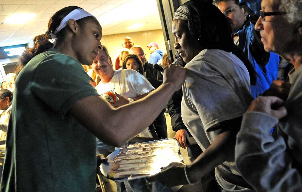 . Minnesota\'s Maya Moore signs an autograph for fan Annice Miller before the game. (Pioneer Press: Sherri LaRose-Chiglo)