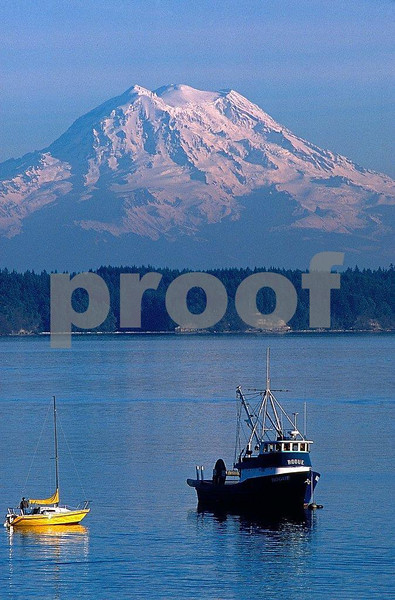 Mt. Rainier and the Rogue fishing boat near the Nisqually Reach of Puget Sound.