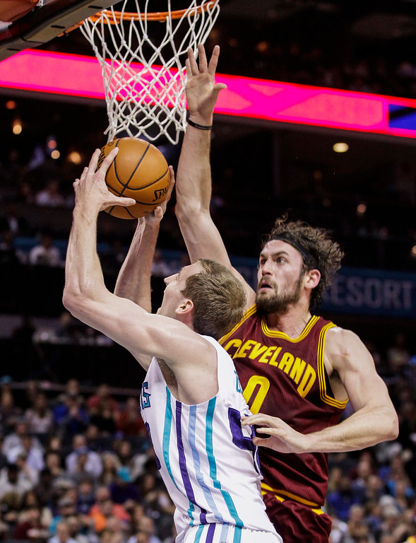 . Cleveland Cavaliers forward Kevin Love,  right, disrupts the shot of Charlotte Hornets forward Cody Zeller during the first half of an NBA basketball game Wednesday, Feb. 3, 2016,in Charlotte, N.C. (AP Photo/Nell Redmond)
