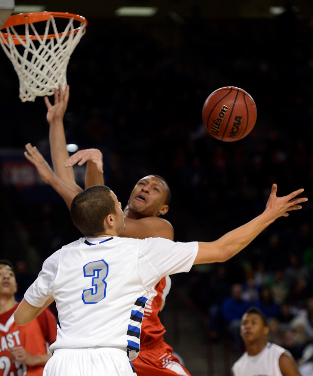 . DENVER, CO. - FEBRUARY 09: Tyre Robinson (32) of East loses control of the ball as Evan Motlong (3) of Highlands Ranch during the first quarter February 9, 2012 at Magness Arena. (Photo By John Leyba/The Denver Post)