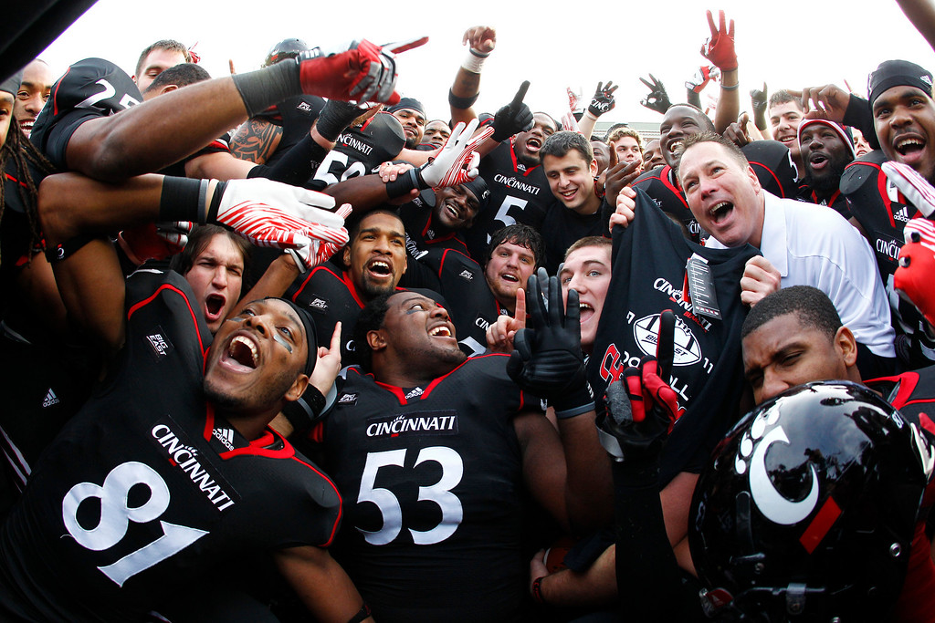 . CINCINNATI, OH - DECEMBER 03:  Head Coach Butch Jones of the Cincinnati Bearcats celebrates with his team after the Bearcats defeated the Connecticut Huskies 35-27 to claim their share of the 2011 Big East Championship on December 3, 2011 at Nippert Stadium in Cincinnati, Ohio. (Photo by Tyler Barrick/Getty Images)