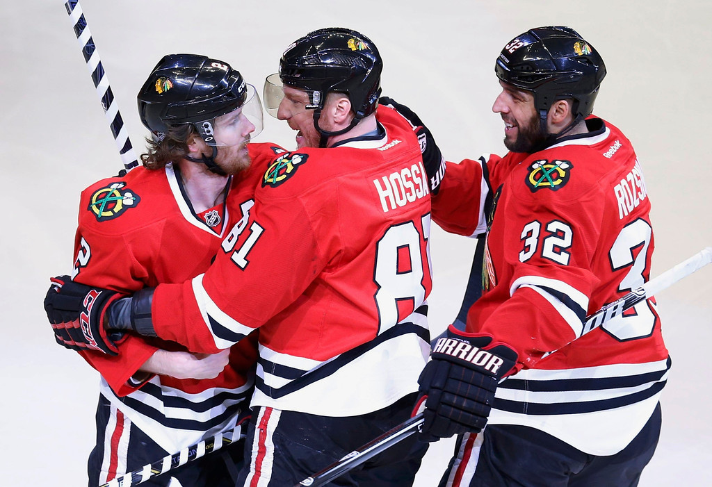 . Chicago Blackhawks\' Duncan Keith (L) celebrates his goal against the Los Angeles Kings with teammates Marian Hossa and Michal Rozsival (R) during the first period in Game 5 of their NHL Western Conference final hockey playoff series in Chicago, Illinois, June 8, 2013. REUTERS/Jim Young