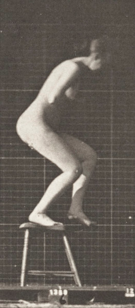 Nude woman stepping on and over a chair