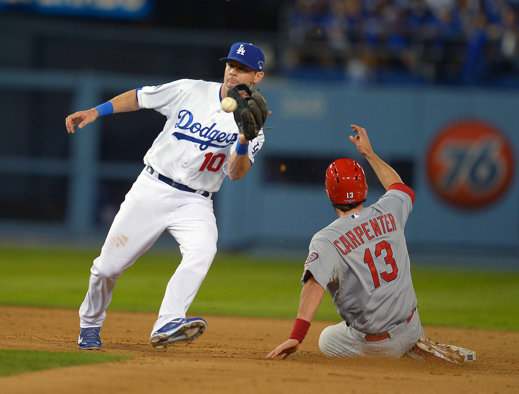 . The Cardinals\' Matt Carpenter steals 2nd as the Dodgers\' Michael Young catches the throw form catcher A.J. Ellis in the 9th during game 4 of the NLCS at Dodger Stadium Tuesday, October 15, 2013. (Photo by Andy Holzman/Los Angeles Daily News)