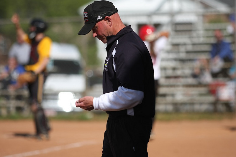 Coach Cole adjusts his pitch counter.