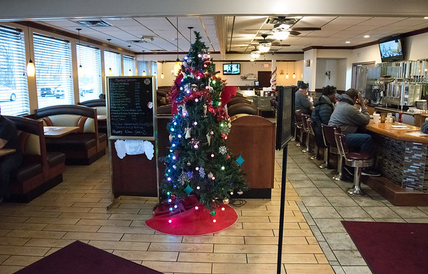 12/31/18 Wesley Bunnell | Staff The dining room at the New Britain Diner on Monday afternoon with most customers siting at the counter.