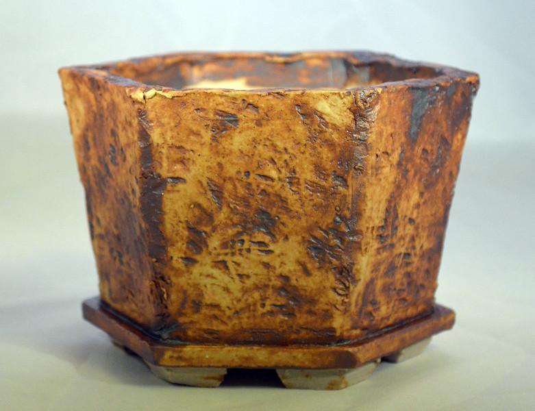 Iron oxide on lava impressed pot 7 x 6 x 4.5 sold