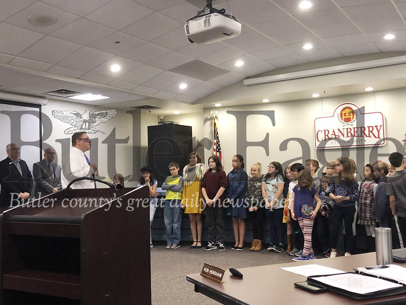 Mike Manipole, Cranberry Township supervisor, address students who volunteered to build a playground in the township during a supervisor meeting Thursday.