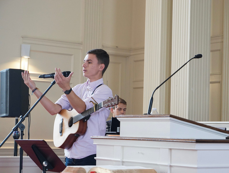 Gabriel Hoyle, guitarist, and Christian Jessup, pianist, lead the congregation in song