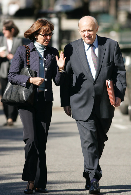 . WASHINGTON - OCTOBER 7:  Judith Miller (L), a New York Times reporter, and her lawyer Floyd Abrams, a First Amendment expert, walk into the E. Barrett Prettyman U.S. District Court October 7, 2004 in Washington, DC. Miller was found to be in contempt of court for not disclosing a source during an federal investigation federal into the disclosure of the name CIA officer Valerie Plame to the press.  (Photo by Brendan Smialowski/Getty Images)