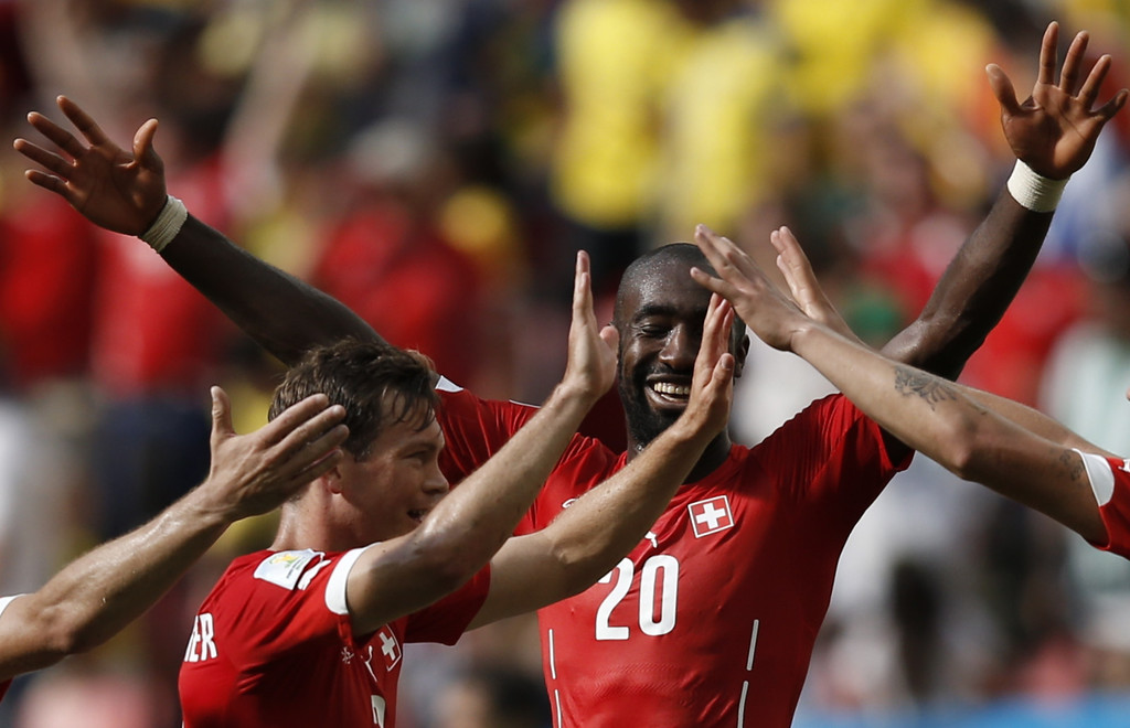 . Switzerland\'s defender Johan Djourou (R) celebrates with his teammates after a Group E football match between Switzerland and Ecuador at the Mane Garrincha National Stadium in Brasilia during the 2014 FIFA World Cup on June 15, 2014.  AFP PHOTO / ADRIAN DENNIS