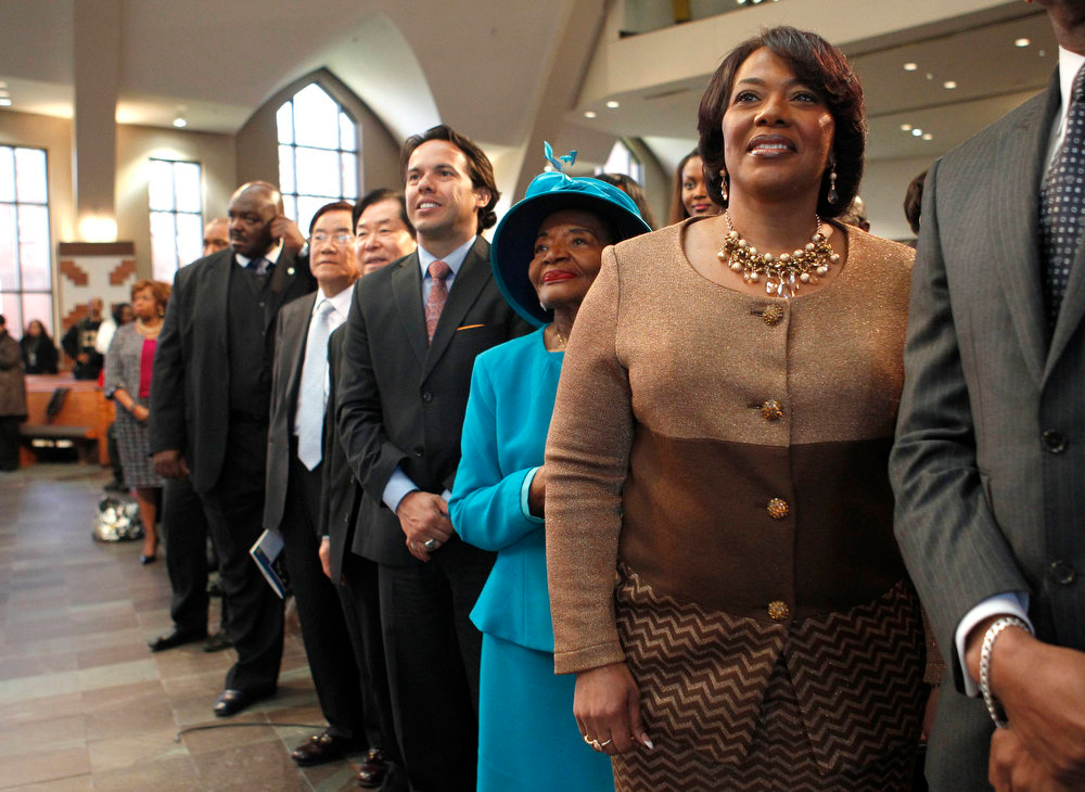 Description of . Rev. Bernice King (R), daughter of slain civil rights leader Martin Luther King, Jr, smiles following the ceremonial swearing-in of President Barack Obama on her father's bible along with Christine King Farris (C), and the  Rev. Samuel Rodriquez as they watch from Ebenezer Baptist Church following the 45th Martin Luther King, Jr. Annual Commemorative Service in Atlanta, Georgia, January 21, 2013. REUTERS/Tami Chappell