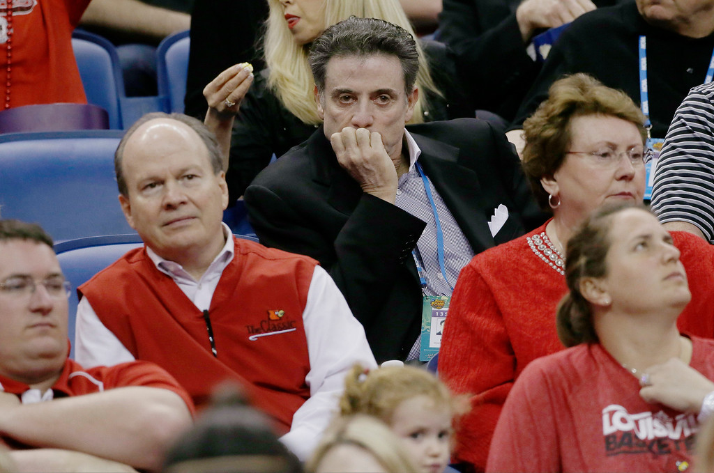 . Louisville men\'s head coach Rick Pitino watches action between Connecticut and Louisville during first half of the national championship game of the women\'s Final Four of the NCAA college basketball tournament, Tuesday, April 9, 2013, in New Orleans. (AP Photo/Dave Martin)