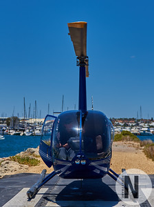 Robinson R44 helicopter preparing for take off at Hillarys Boat Harbour
