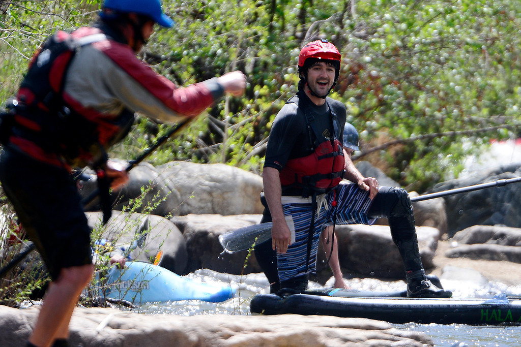 . Peter Hall laughs as he takes a break from his board during Golden Games at the Clear Creek Whitewater Park. (Photo by AAron Ontiveroz/The Denver Post)